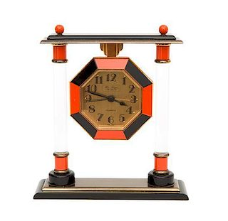 A French Enameled Table Clock Height 5 inches.