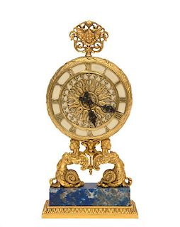 A Continental Gilt Bronze Table Clock Height 8 inches.