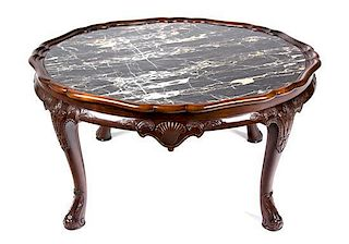 An English Mahogany Low Coffee Table Height 19 x diameter 38 inches.
