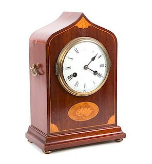An English Inlaid Mahogany Lancet Clock Height 13 1/2 x width 9 1/4 x depth 5 inches.