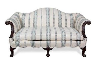 A Chippendale Style Mahogany Camel Back Love Seat Height 34 x width 64 x depth 36 inches.