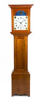 An American Tall Cherry Case Clock Height 76 1/2 x width 19 3/4 x depth 11 1/2 inches.