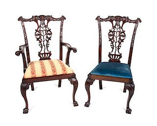 A Set of Twelve Chippendale Style Mahogany Dining Chairs Height 41 inches.