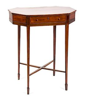 A Sheraton Style Satinwood Work Table Height 28 1/4 x width 23 x depth 13 3/4 inches.