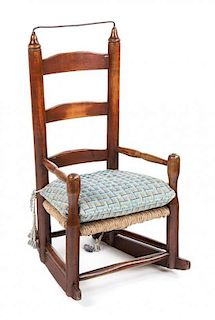 An American Ladder Back Child's Rocking Chair Height 25 1/2 inches.