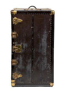 A Brass Mounted Black Steamer Trunk Height 25 x width 39 x depth 22 inches.
