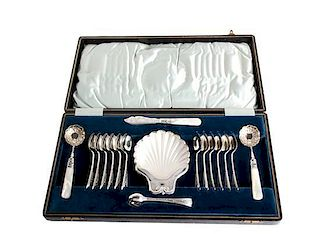 An English Silver Plate and Mother-of-Pearl Handled Dessert Set Length of largest spoon 6 inches.
