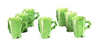 A Set of Seven Dodie Thayer Lettuce Ware Mugs Height 5 1/4 inches.