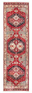A Persian Wool Runner 12 feet 6 inches x 3 feet 6 inches.
