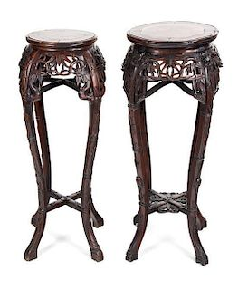 Two Chinese Export Carved Rosewood Pedestals Height of taller 37 inches.
