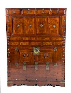 A Korean Elmwood Storage Cabinet Height 46 1/2 x width 15 1/2 x depth 34 1/2 inches.