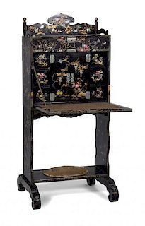 A Japanese Black and Gilt Lacquer Mother-of-Pearl Inlaid Writing Desk Height 53 x width 48 x depth 16 1/2 inches (closed).