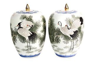 A Pair of Japanese Porcelain Ovoid Form Covered Vases Height 12 inches.