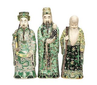 Three Chinese Export Famille Verte Partial Glazed Figures Height of tallest 26 1/4 inches.