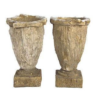 A Pair of Composition Garden Urns Height 16 inches.