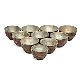 COCONUT AND PEWTER TEACUPS