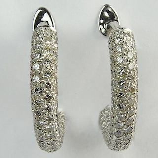 Impressive Pair of 13.80 Carat Pave Set Round Cut Diamond and 18 Karat White Gold Hoop Earrings.