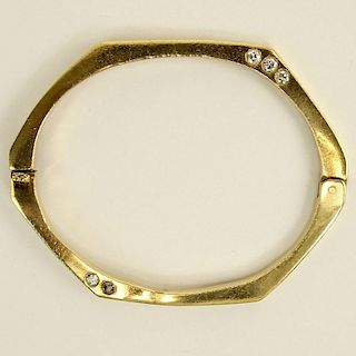 Vintage 14 Karat Yellow Gold Bangle Bracelet accented with Ten (10) Round Cut Diamonds.