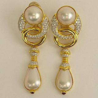 Pair of Mabe Pearl, Approx. 3.20 Carat Micro Pave Set Diamond and 14 Karat Yellow Gold Pendant Earclips.