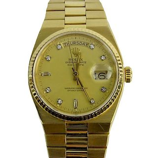 Men's 18 Karat Yellow Gold Rolex Oyster Quartz Day Date Watch.
