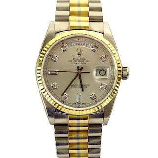 Men's Rolex 18 Karat Gold Tridor Oyster Perpetual Day Date President Chronometer watch.