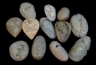 Twelve Assorted  Jadeite And Jade Pendants