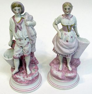 Pair Of Fancily Dressed Figurines