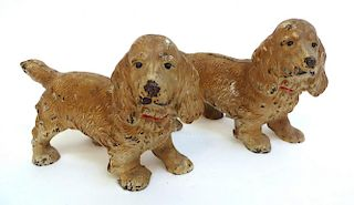 Two Identically Painted Cocker Spaniel Dogs