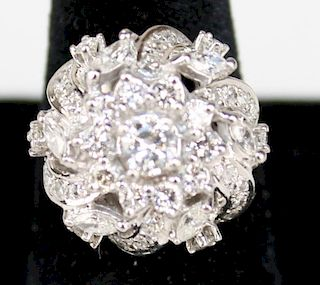 14k w.g. ladies diamond ring, center ¼ rd cut diamond surrounded by extravagant floral form setting