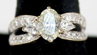 18k w.g. ladies diamond ring. Center oval cut diamond 7.2mm x 5.2mm x 3mm. Approx. _ct. Each side is
