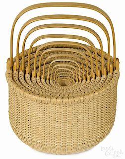 Nest of twelve Darryl Arawjo Nantucket splint oak baskets, signed and dated 2004