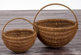 Darryl Arawjo, two baskets, signed and dated 1998, 8'' h. and 6'' h.