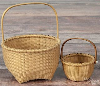 Karen Wychock, two splint baskets, initialed, one dated '94, 6'' h. and 3 1/2'' h.