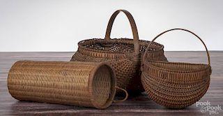 Three splint oak baskets, 19th c., to include a gathering basket, a wall basket