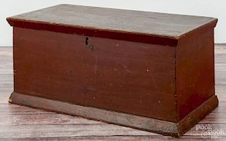 Pennsylvania painted pine valuables box, ca. 1840, retaining an old red surface, 10 3/4'' h., 22'' w.