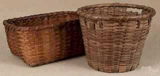 Two large splint oak gathering baskets, 19th c., 15'' h. and 10 1/2'' w.