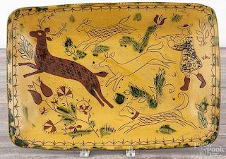 Lester Breininger, large redware platter, dated 1988, with a deer hunting scene, 19 1/4'' w.