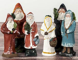 Six contemporary chalkware belsnickle Santa Claus figures, four initialed HD, tallest - 10 3/4''.