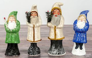 Four contemporary chalkware belsnickle Santa Claus figures, two labeled Ino Schaller