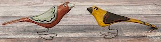 Daniel Strawser, two carved and painted birds, initialed and dated '86, on wire heart-form bases