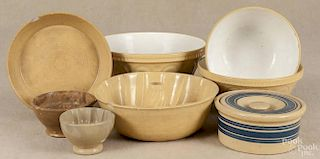 Eight pieces of yelloware, ca. 1900, to include a nest of three English bowls, three food molds