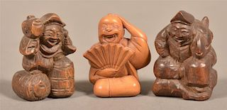 Three Carved Wood Chinese Figural Netsukes.