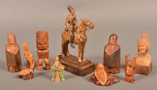 Nine various figural wood carvings.