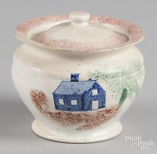 Red spatter covered sugar with blue schoolhouse decoration, 4 1/2'' h.