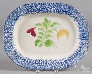 Blue sponge spatter platter with floral decoration, 15'' l., 19'' w.