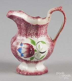 Red spatter creamer with tulip decoration, 5 5/8'' h.