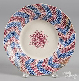 Blue and red sponge spatter soup bowl with star decoration, 10 3/8'' dia.
