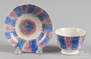 Miniature blue and purple spatter cup and saucer.