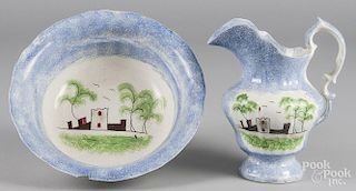 Blue spatter pitcher and basin with fort decoration, 10 1/4'' h. and 4 1/2'' h., 12 1/4'' dia.