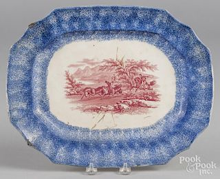Blue spatter platter with red transfer decoration of a Peruvian Horse hunt, 10 3/4'' l., 23 3/4'' w.